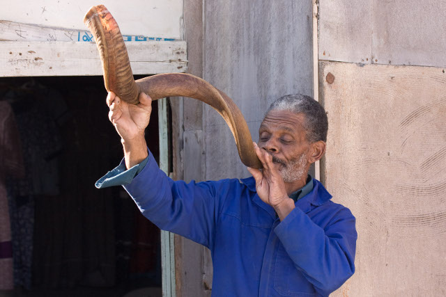 Nama man blowing a greeting