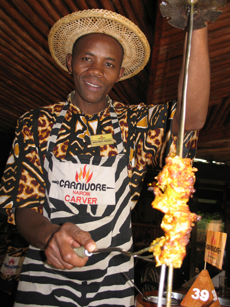 A carver at Carnivore restaurant, Nairobi. Photo by Susan McKee.