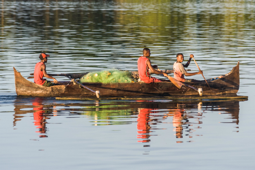 Malagasy fishermen in a traditional outrigger canoe (Shutterstock)
