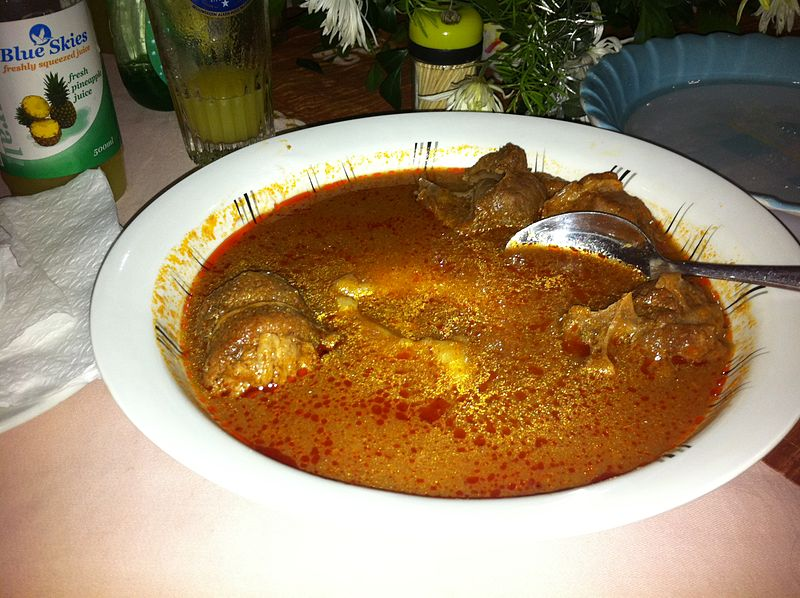 Fufu in tomato soup with goat (by sshreeves, Wikimedia Commons)