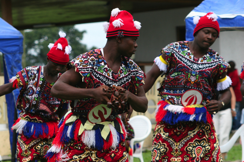Igbo men are performing a traditional dance in Port Harcourt, Nigeria (Lorimer Images / Shutterstock.com)