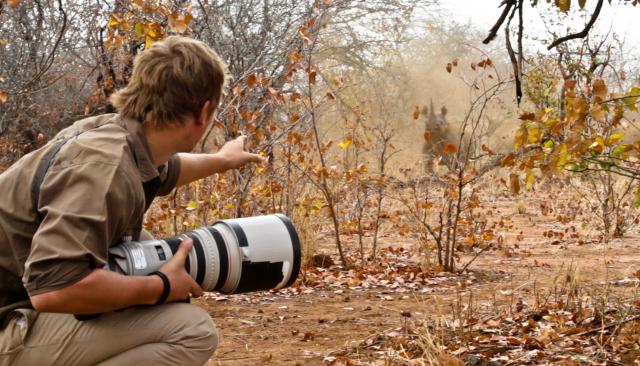 James spots a rhino in the bush.