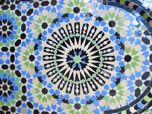 Hours of careful placement of ceramic tiles result in elaborate mosaic designs for architectural use. (Photo ©2013 by Susan McKee)
