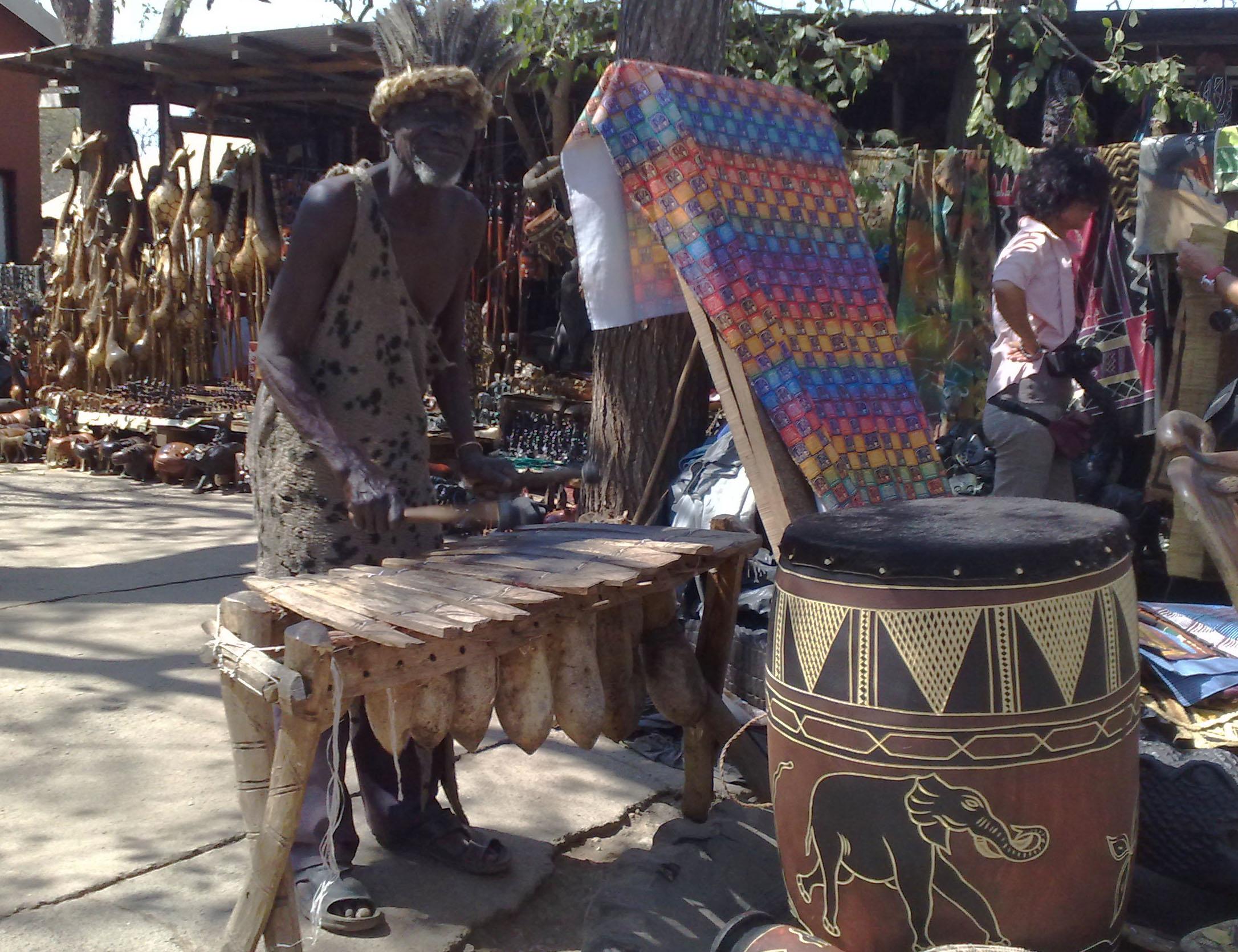 Silimba in a market, Lukasa (wikipedia)