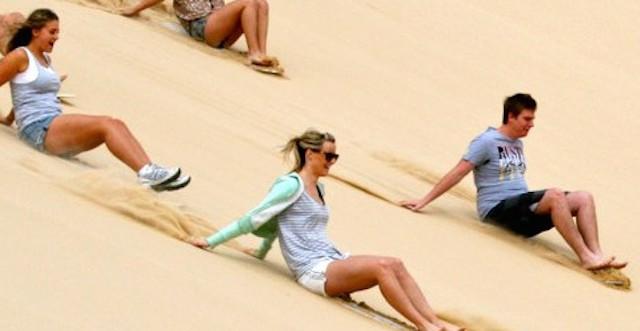 sandboarding stockton dunes in australia