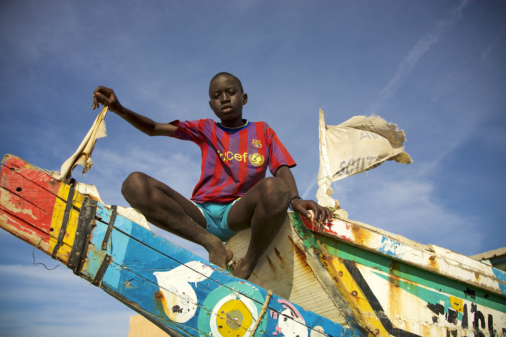saint louis senegal boy on boat