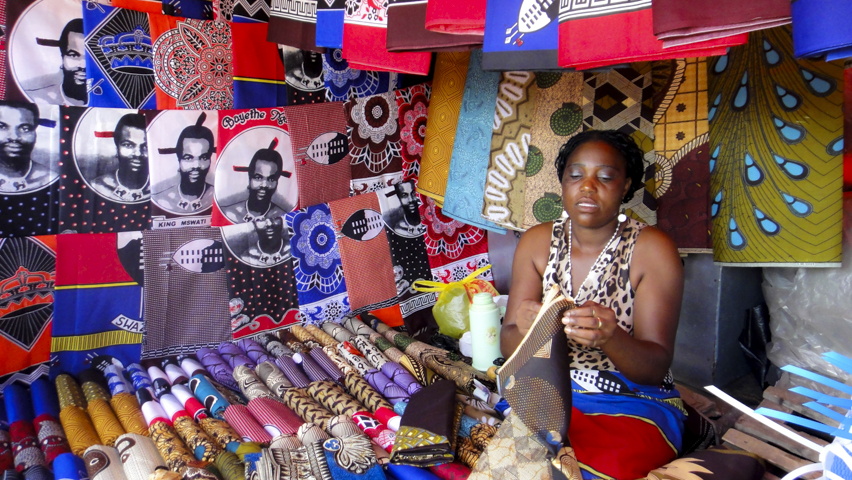 Brightly printed Swazi cloths are worn tied aroung the body and often depict the face of the king, Mswati III