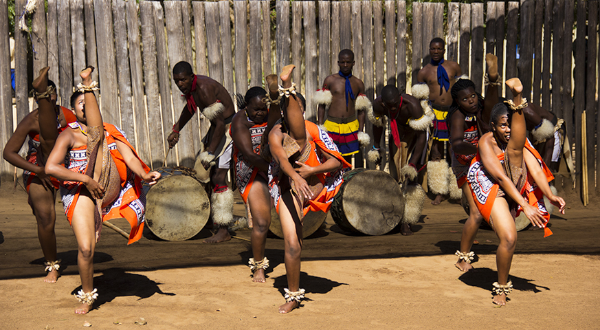 Traditional Swazi dancers perform at Mantenga Cultural Village near Mbabane. Girls compete for male attention by seeing who can kick the highest - Copy